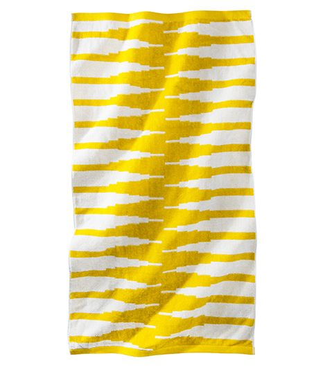 Amp Up Your Swimwear Style With A Chic Beach Towel via @WhoWhatWear
