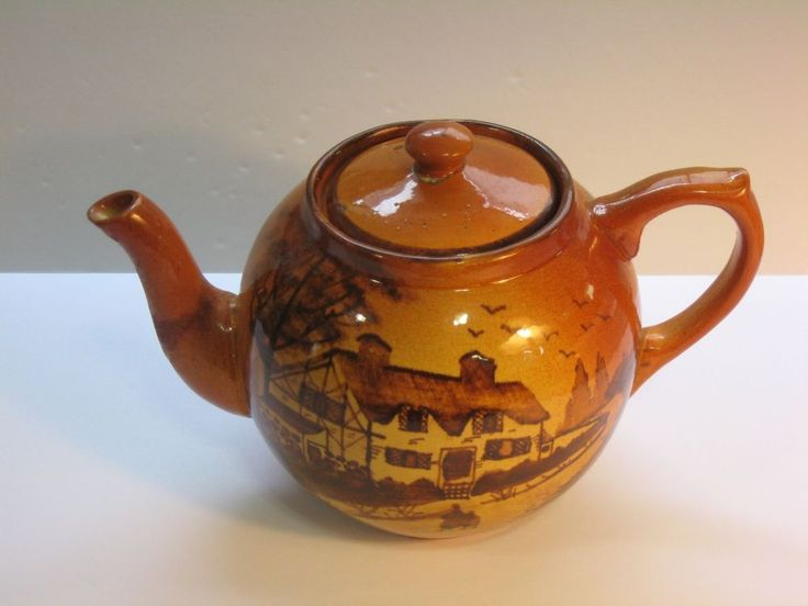 Medalta Potteries Limited caramel coloured teapot painted with country thatched cottage scene, c. 1940s-1960s, ceramic, Medicine Hat, Alberta, Canada