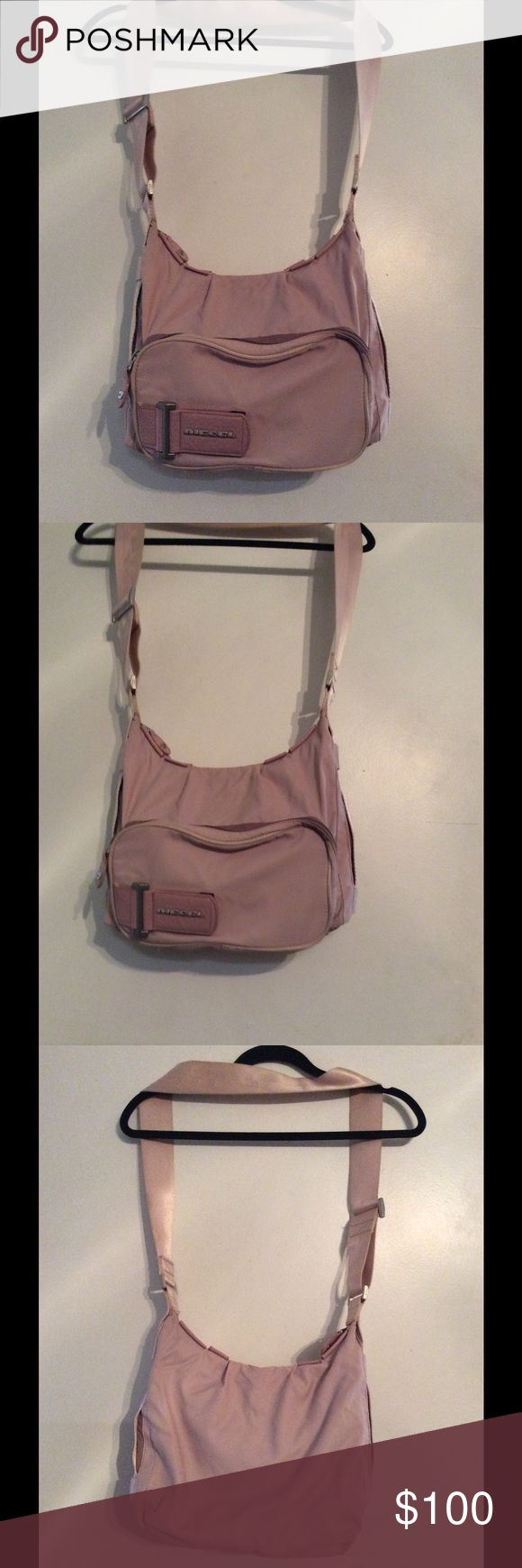 DIESEL PURSE/CROSSBODY PURSE PINK NYLON w/Adjustable Shoulder Strap. Excellent Condition. Large exterior zipper front pocket. 2 Interior slip pockets. 1 Interior zipper pocket. Velcro divided Interior. Diesel Bags Crossbody Bags