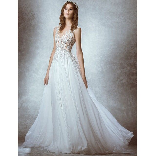 For this #fall2015 #bridal collection, #zuhairmurad included silk chiffon in one of his designs, using mostly sheer fabric and delicate kinds of beads for the upper half  Photography: @rabeeyounes