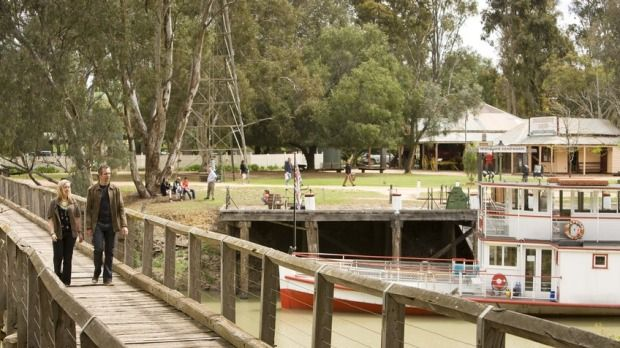 Couple walking across the Murray River at Pioneer Settlement in Swan Hill, The Murray