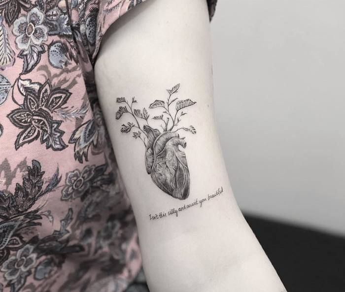 Anatomical Heart Tattoo on Bicep by Nando Tattoo