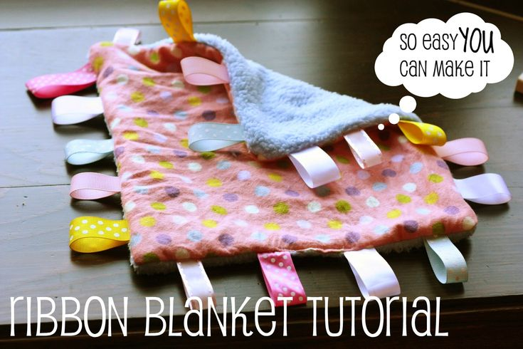 Homemade ribbon blanket (make it crinkly by adding a cut-to-size piece of crinkly chip wrapper between the layers)