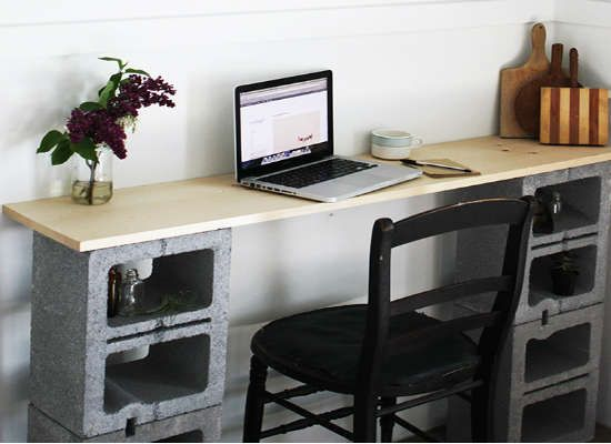 DIY desk with cinder blocks and a wood board—super easy and sturdy