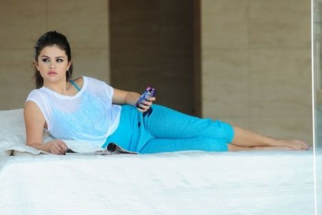 "Selena Gomez posing for her Dream Out Loud clothing line holding a ""Watersnake"" iPhone case by Case Mate whom she has partnered with."