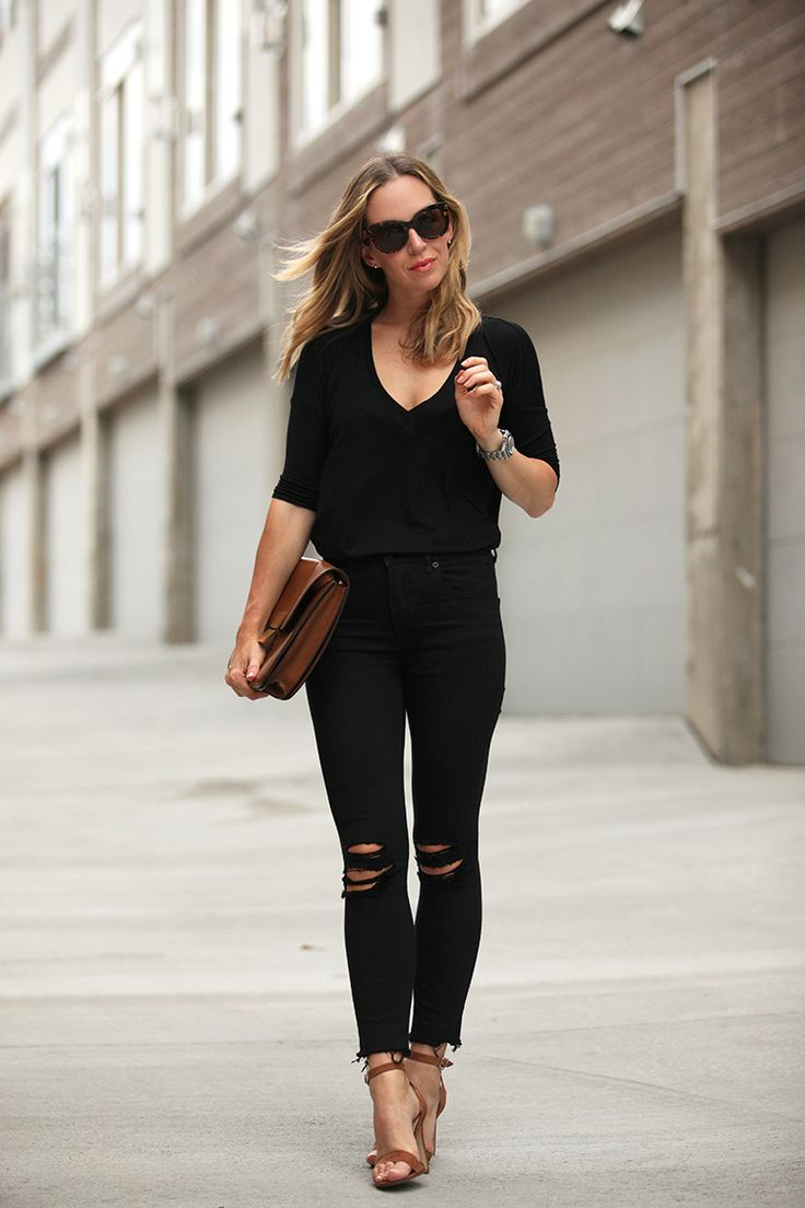 ... proves that ripped jeans are forever: just match them with a black  sweater and heels! Tee: Express One Eleven, Jeans: Express, Shoes: Steve  Madden ""
