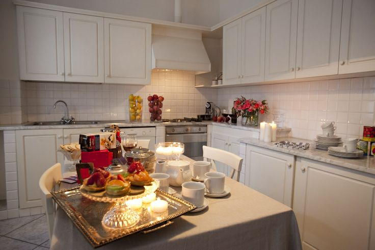 The kitchen in San Giovanni apartment  white Carrara marble and wood. www.florencewithaview.com