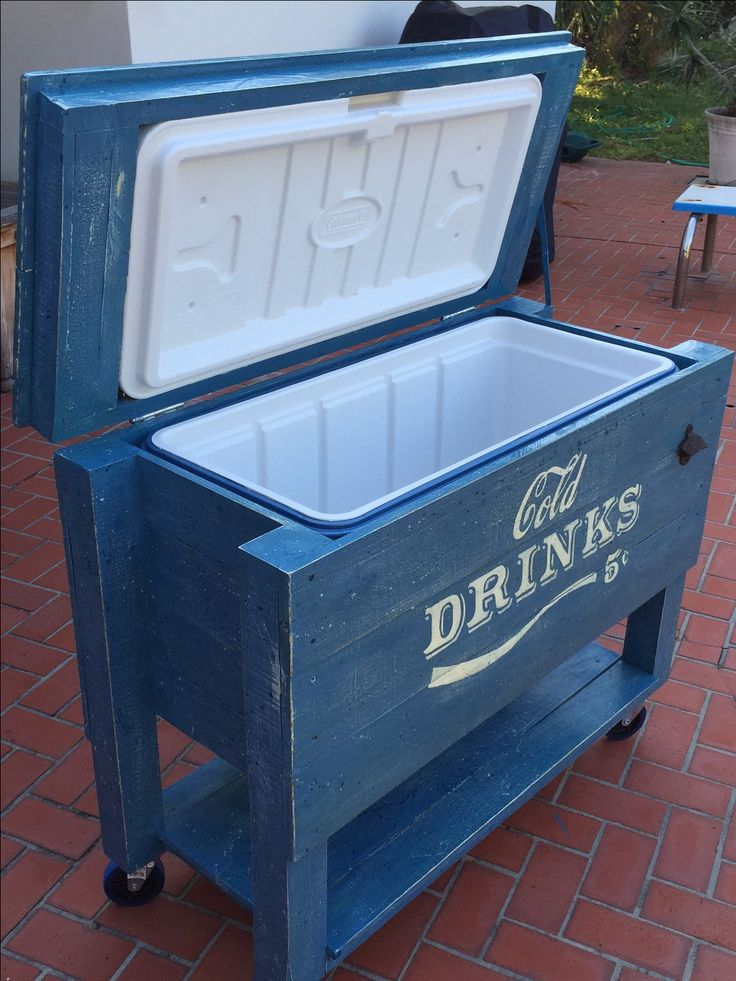 Party patio cooler, handmade with old fence boards and pallets. then stenciled with a Coke and shadowed serif font, distressed blue finish. DIY