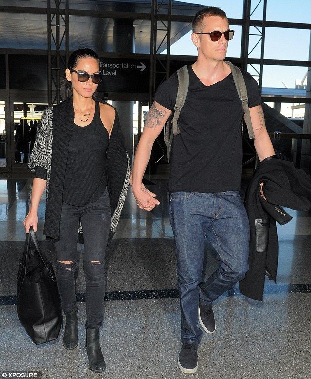 Time for croissants! Olivia Munn and boyfriend Joel Kinnaman held hands as they headed into LAX on Saturday to board a flight to France