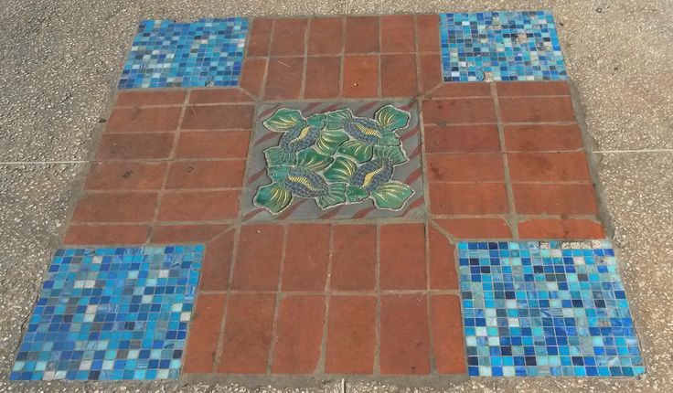Tile mosaic along the pavement in St. Lawrence Gap, Barbados