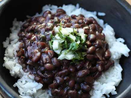 Brazilian black beans & rice Will have to try this vegetarian! Maybe instead of ham hock, soak in veg stock!
