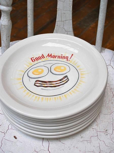 This has got to be the perfect plate to serve up some bacon and eggs! The durable, creamy-white, commercial-grade china is American-made and will stand up to years of daily use. With its narrow rim & slight well, the plate will cheerfully handle your home-run breakfast! Withegg yolkeyes and a bacon smile, who could deny the happy charms of this plate?  Who wants bacon and eggs? We do! Sunny side up, please with a side of crispy bacon! Dishwasher, Microwave and Oven Safe. 9 3...