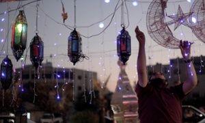 A street vendor plugs in decorations for Ramadan in Amman, Jordan.