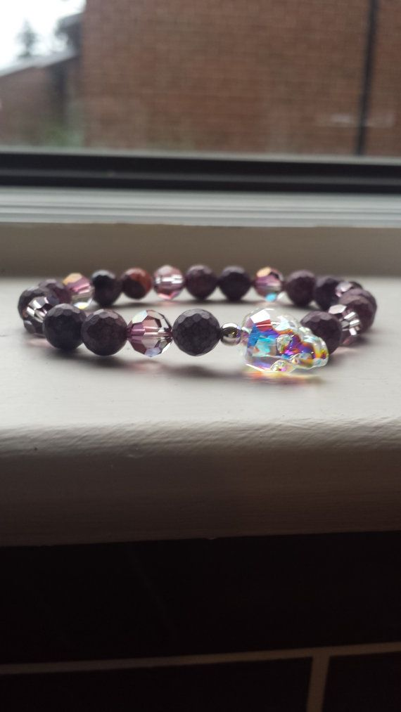 https://www.etsy.com/listing/195039229/sugar-skull-bracelet?ref=related-6    Swarovski Innovations 2015 Skull Bead Crystal AB 14*13*10mm  8mm Swarovski Rounds in Lilac Shadow  Swarovski Round 8mm Lilac Shadow Beads on The Crystal AB   Matte Purple Died Jasper Reptile Print beads in 8mm on stretch cord