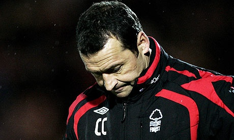 Colin Calderwood. (Regularly seen looking to the floor for inspiration.)