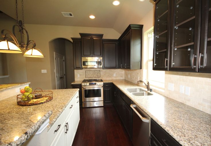 Kinsmen homes shea plan kitchen white kitchen island for Cappuccino color kitchen cabinets
