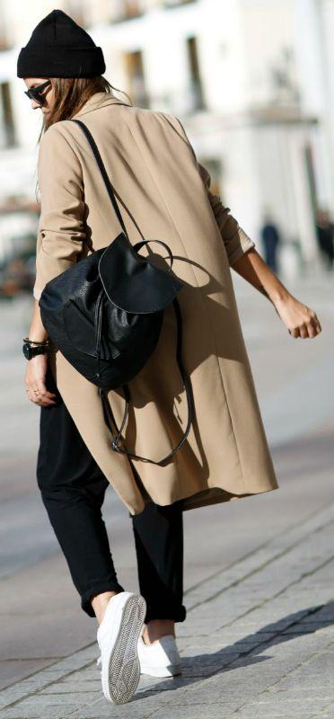 Natalia Cabezas + black and beige combination + sleek and trendy style + camel coat + black slacks + cute leather backpack  Jacket: Oak&Fort, T-shirt: Anine Bing, Trousers: Zara, Sneakers: Adidasm Backpack: Levi's.