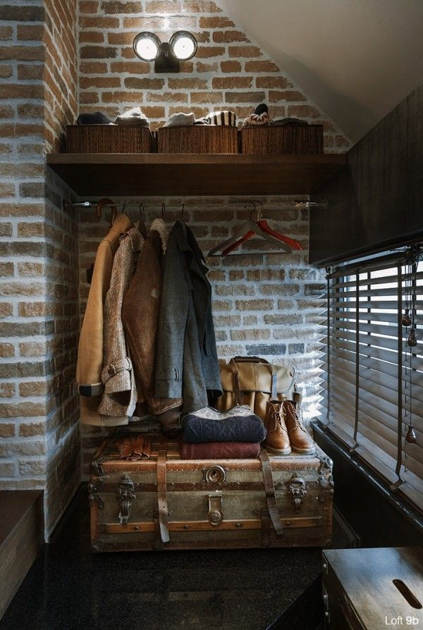 Storage is always a challenge in smaller apartments. But from an open-air coat closet to a wardrobe hidden inside what looks like a vintage suitcase, the space does not lack for practical storage. Even the coffee table, also styled as a suitcase, opens up for blankets and other comforts.