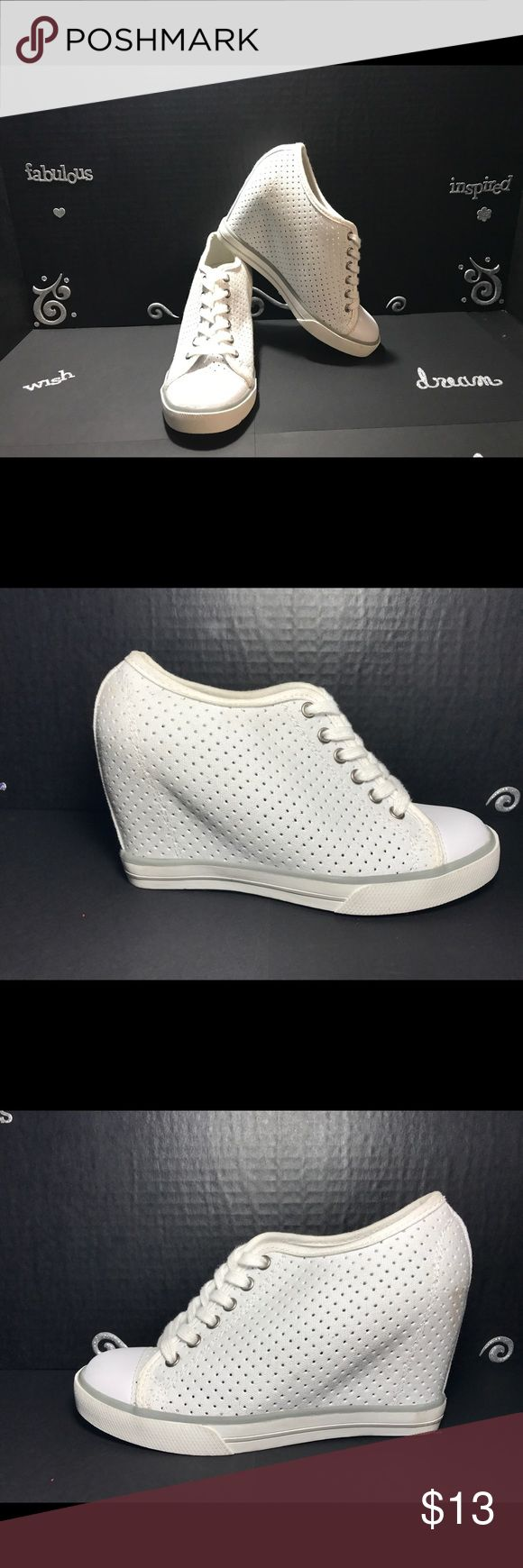 SO hidden wedge sneakers Jump up in style with these hidden wedge SO sneakers, with a 3-in hidden wedge, lace up closer. These shoes are new from store display and however they were stored and have slight scuffs as seen on pictures. SO Shoes Sneakers
