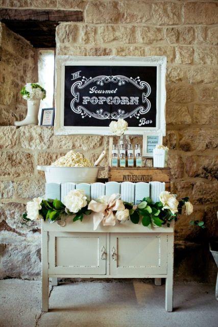 26 Wedding Reception Popcorn Station Ideas. A vinage dry sink and framed chalkboard were used to set up this elegant popcorn station.