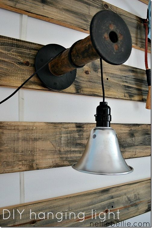 DIY light from shop light and wooden spool (or any kind of bracket). how cool is this!! from http://www.nelliebellie.com