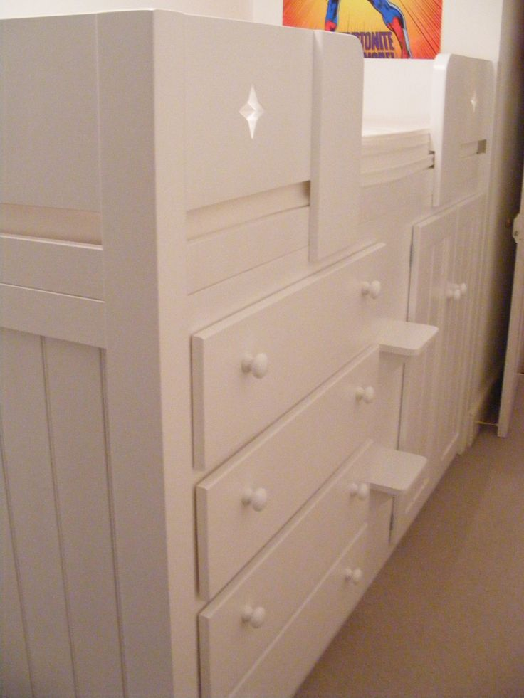 4 Drawer childrens cabin bed in all white. The front rails have star cutouts which the child chose. The bed is made from solid natural pine and is guaranteed for 20 years, we've never had one break! Design your perfect bed at www.aspennfurniture.co.uk or contact us on 01937 843386 / ianaspenn@btinternet.com
