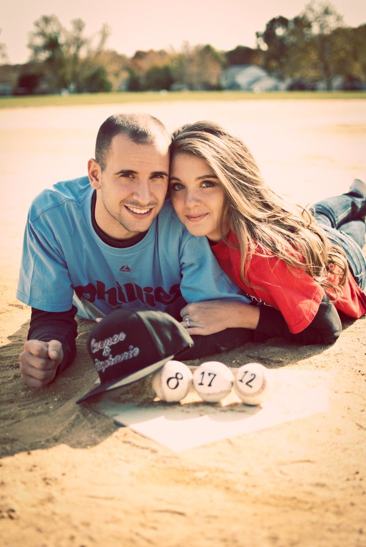 baseball engagement photos #redsox #phillies we both adore our teams so we wanted to represent our friendly rivalry #pizzoroycewedding