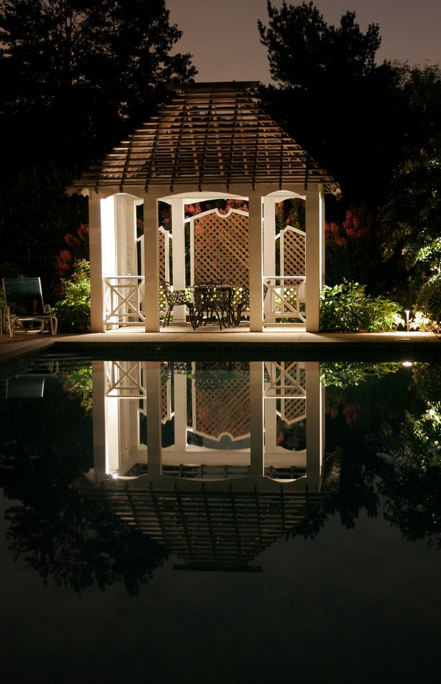 gazebo beside pool with white wooden poles and rails, black chairs set, wooden nets partitions, wooden nets roof of Stunning Outdoor Lights for Gazebo and Pergola