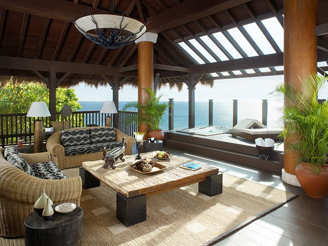 Relax on the deck area of Treehouse Villa and take a dip in your private jacuzzi