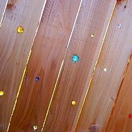 Marble Fence Make your fence sparkle with marbles! It's easy... all you need is a drill, rubber mallet, marbles, and a fence!