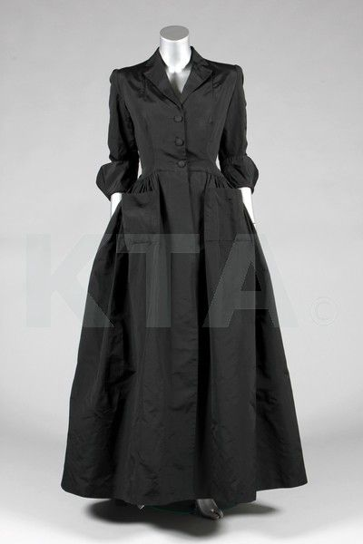A Balenciaga couture black silk evening coat, late 1940's…