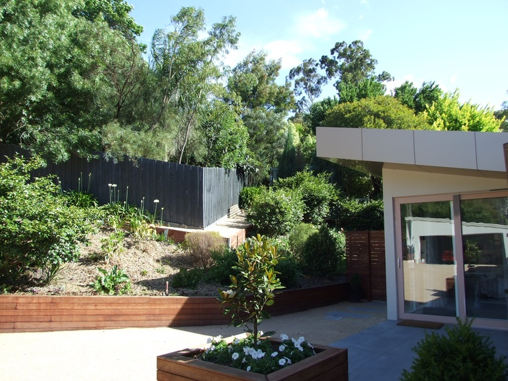 retaining walls clad in Merbau - still sampling paint colours for window joinery