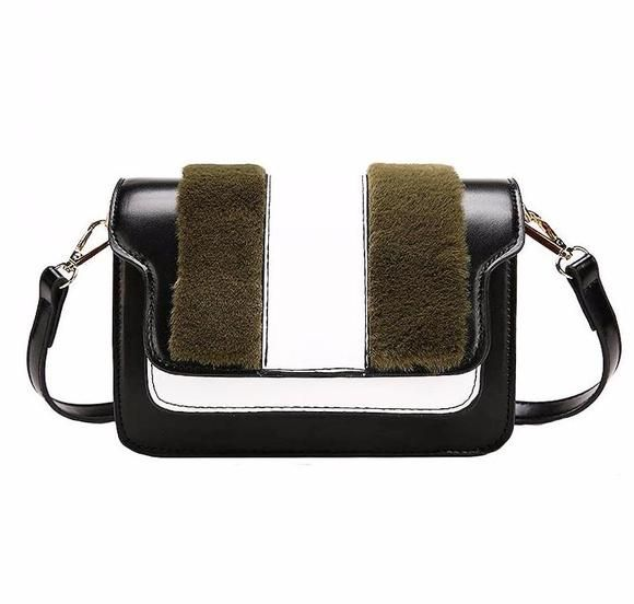 Compact and Sassy, the Ballie cross-body bag is perfect for a girls night out! Carry this bag with the included adjustable cross-body strap with chain detailing. It's made from faux leather and faux fur.