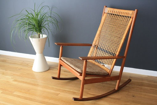 Mid-Century rocker with woven cane back was designed by Hans Olsen for Dux.  $960 at midcenturymodernfirds.com