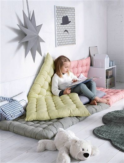 layered mats make an awesome reading nook