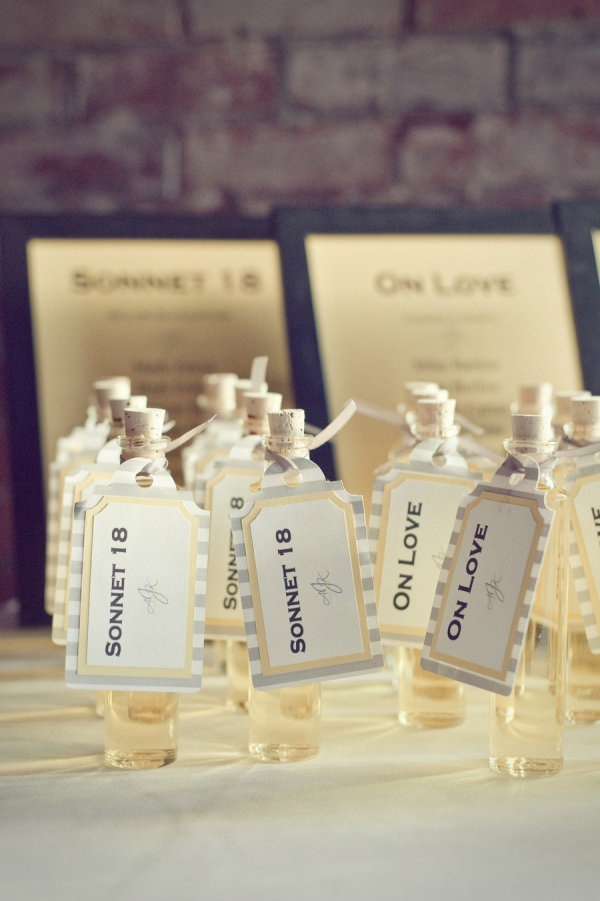 homemade Limoncello favors with seating assignments. The tables were named after the couple's favorite love poems. so sweet  Photography by http://drewandmeganphotography.com