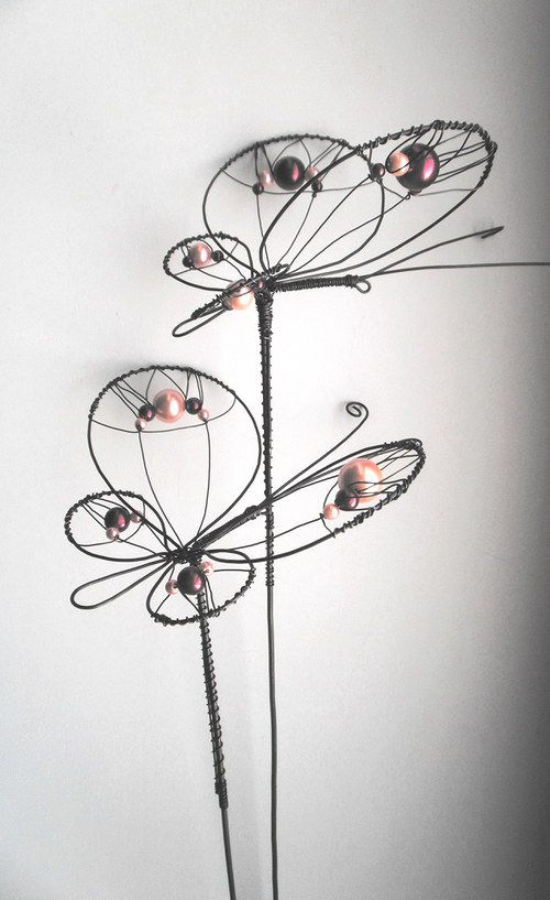 Uitsparing vlinder  spurs an idea of how to make a butterfly or dragonfly body for stained glass.  wrap copper wire around thick wire or maybe use copper tubing