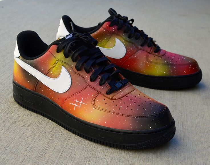 These one-of-a-kind hand-painted Air Force Ones Low Sneakers have been carefully hand-painted with what we call our 'Solar Flare Galaxy' featuring a red, yellow and orange galaxy pattern. Black midsol