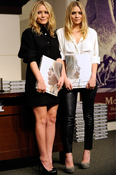 Ashley Olsen: Leather pants and Feminine blouse...Look at those scalloped sleeves!