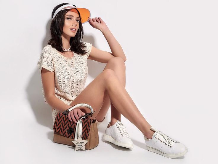 Ride the white sneaker & make sure you pair it with an equally impressive handbag!