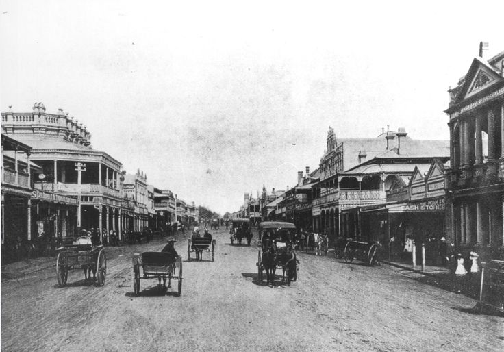 The grand looking building on the left is the Globe Hotel which first opened in 1866 on the corner of Bell Street and Ruthven Street (today there is a Bakery, Mary Ryan book store and the Heritage Bank at this location).   On the right hand side of the picture the first building is the Bank of Australia. In the distance the clock tower of City Hall can be seen #fromthearchives #toowoomba #history #horsedrawncart