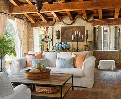Give your living room a light, easy feel with relaxed upholstery, rough-hewn wood furnishings, and paintings of Italian vistas. Lighting and accents in raw wood and iron make perfect finishing touches.