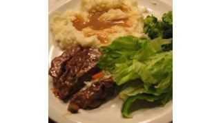 Succulent round steak seared, then braised in cream of mushroom and French onion soups until tender. Great with mashed potatoes, as it makes it's own gravy.
