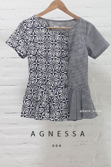 Agnessa 004 Contemporary Asymmetrical Buttoned Batik Contemporary Kawung and Checkered Combination Peplum Blouse  Length of Blouse : approx. 62 cm.  Material Used : Batik Cap, Cotton / Checkered Fabric, Japanese Cotton.