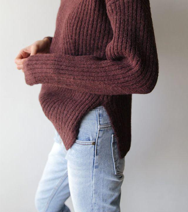 Light denim and dark red sweater.