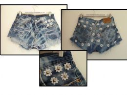 Acid wash vintage levis shorts, with studded daisies