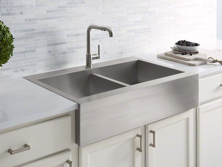 Vault™ The clean lines and traditional farmhouse style of the Vault apron-front sink integrate seamlessly in a variety of kitchen spaces. Handcrafted from durable stainless steel, this double-bowl sink features tightly angled corners to maximize basin space, and a top-mount design for easy installation and use on most laminate countertops. Vault's ultra-flat rim makes it easy to wipe from the counter directly into the sink. For added convenience, Vault's shortened Self-Trimming® integral…