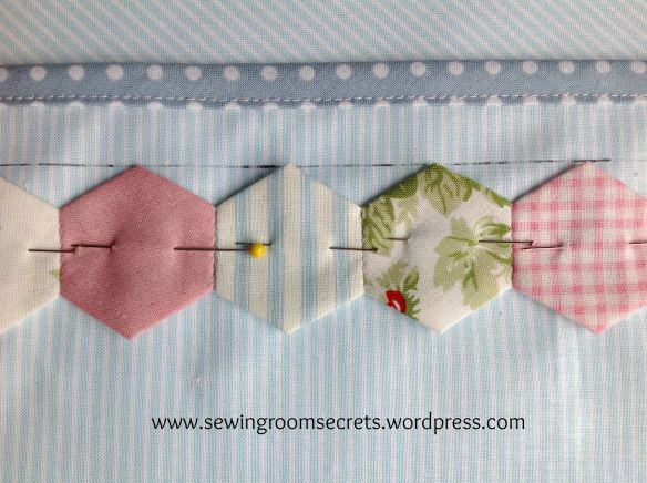 Hexy border - love the pink hexes against the fine blue stripes & the border !