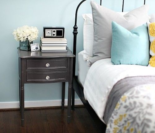 Bedroom - grey, yellow, and blue palette with painted bedside tables.