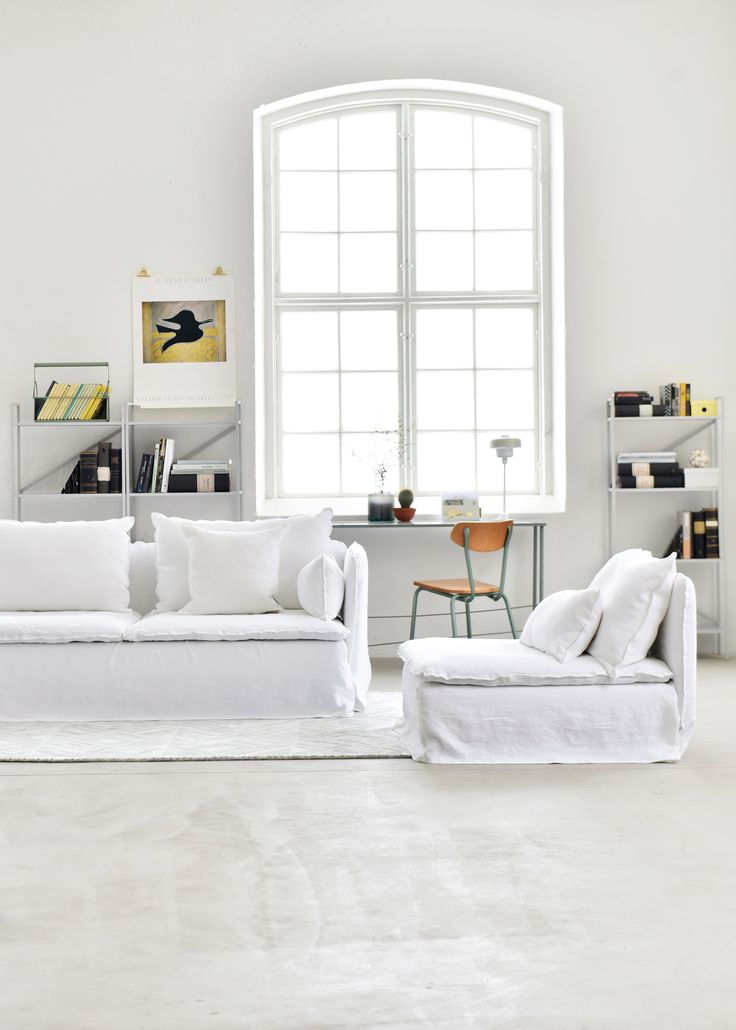 white minimal industrial style living | huge industrial windows and concrete floors | IKEA Söderhamn sofa with a Loose Fit Bemz cover | modern living room decor | White linen sofa | Ghost inspired sofa